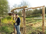 Jocelyn sowing a cover crop by the sturdy new trellis system at the Urban Aboriginal Intergenerational Garden.
