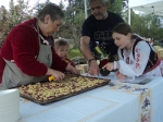 Georgie Riha and her family confer on the slicing of Czech Kolach.