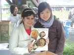 UBC students showing off Joy of Feeding booklets with recipes and biographies from all of the moms.