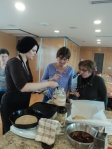 Participants learning the nutritional principles and hands-on skills of making dosas from fermented grains. Surprisingly easy, and oh-so tasty!